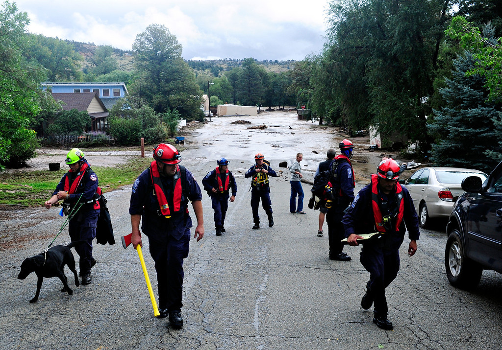 . Crews from Colo. Task Force Urban Search and Rescue searched flooded areas for stranded or missing persons in Lyons Friday, Sept. 13, 2013. (Greg Lindstrom/Times-Call)