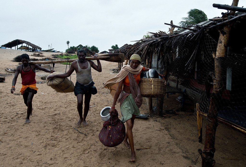 . Indian fishermen salvage their belongings as they evacuate their homes in Donkuru village in Srikakulam district on October 12, 2013.Nearly half a million people have been evacuated from India\'s impoverished east coast ahead of a massive cyclone expected to make landfall on October 12 evening, disaster officials said.  MANAN VATSYAYANA/AFP/Getty Images