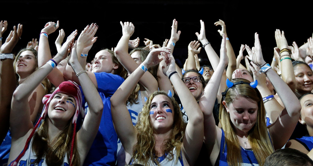 . Duke fans cheer during the team\'s Countdown to Craziness NCAA college basketball preseason event in Durham, N.C., Friday, Oct. 18, 2013. (AP Photo/Gerry Broome)