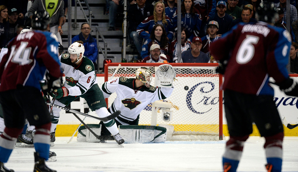 . DENVER, CO - APRIL 26: Colorado Avalanche center Nathan MacKinnon (29) gets the game winning goal past Minnesota Wild goalie Darcy Kuemper (35) early in overtime. The Avalanche defeated the Wild 4 to 3.  The Colorado Avalanche hosted the Minnesota Wild in the fifth round of the Stanley Cup Playoffs at the Pepsi Center in Denver, Colorado on Saturday, April 26, 2014. (Photo by John Leyba/The Denver Post)