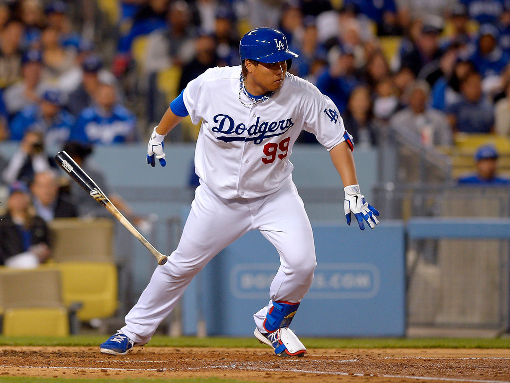 . Los Angeles Dodgers\' Ryu Hyun-jin, of South Korea, bunts into a double play during the second inning of their baseball game against the Colorado Rockies, Tuesday, April 30, 2013, in Los Angeles. (AP Photo/Mark J. Terrill)