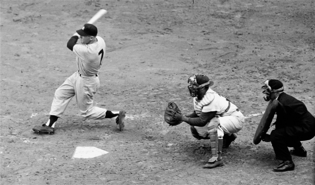 . New York Yankees outfielder Mickey Mantle connects with relief hurler Russ Meyer\'s first pitch in the third inning to smash a homer into the left center field stands with bases loaded.  Roy Campanella is the Brooklyn Dodgers catcher.  Mickey\'s grand slammer was only the fourth such blow in World Series history.  It came in the fifth 1953 World Series tilt, won by the Yankees at Ebbets Field in Brooklyn, 11-7, October 4, 1953.  Yankees now lead in the Series three games to two.  (AP Photo)