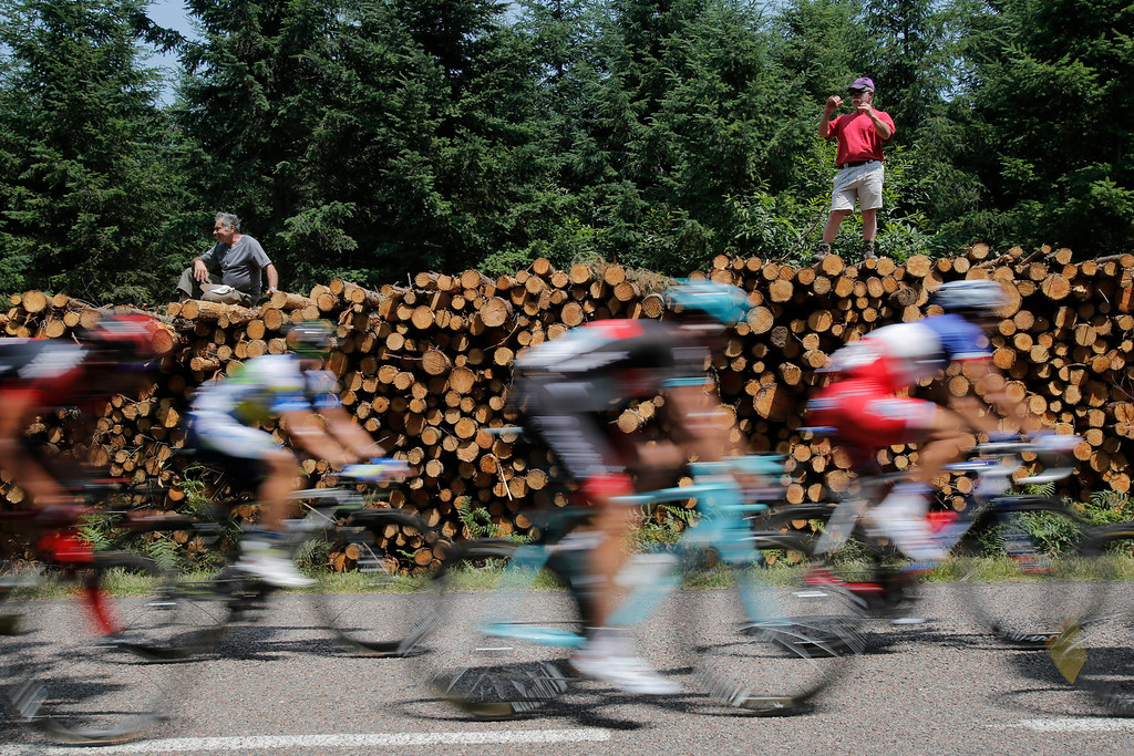 . Spectators watch the breakaway group pass during the fourteenth stage of the Tour de France cycling race over 191 kilometers (119.4 miles) with start in in Saint-Pourcain-sur-Sioule and finish in Lyon, central France, Saturday July 13 2013. (AP Photo/Christophe Ena)