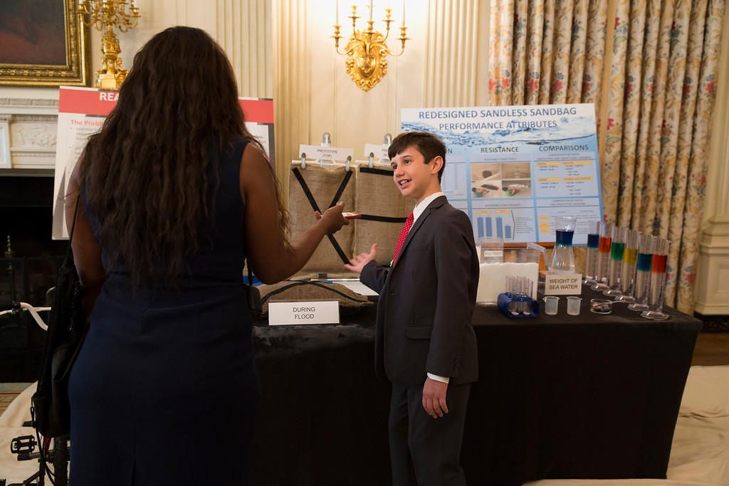 ". Peyton Robertson, 12, of Ft. Lauderdale, Fla., shows off his ""sandless\"" sandbag during the 2014 White House Science Fair, Tuesday, May 27, 2014, at the White Housein Washington. (AP Photo/ Evan Vucci)"