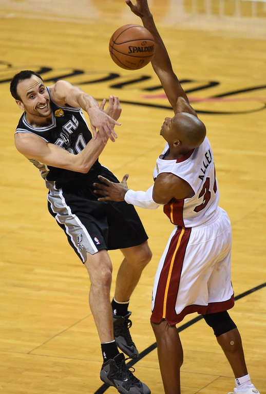 . Ray Allen (R) of the Miami Heat defends against  Manu Ginobili (L) of the San Antonio Spurs during Game 4 of the 2014 NBA Finals on June 12, 2014  at the American Airlines Arena in Miami, Florida.  TIMOTHY A. CLARY/AFP/Getty Images