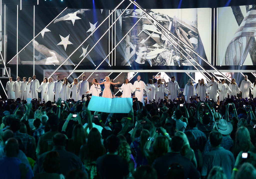. NASHVILLE, TN - JUNE 05:  Carrie Underwood performs onstage during the 2013 CMT Music awards at the Bridgestone Arena on June 5, 2013 in Nashville, Tennessee.  (Photo by Jason Merritt/Getty Images)