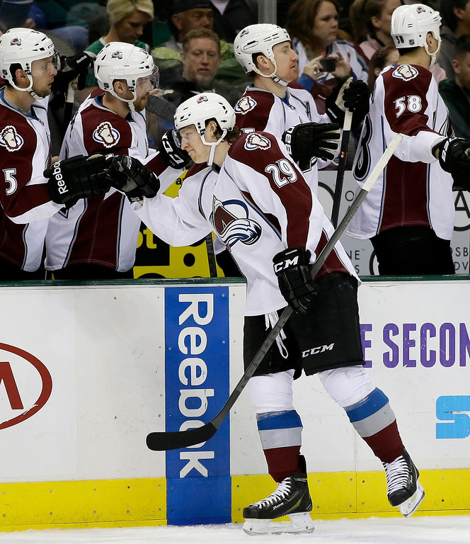 . Colorado Avalanche center Nathan MacKinnon (29) is congratulated by the bench after scoring against the Dallas Stars in the first period of an NHL hockey game, Monday, Jan. 27, 2014, in Dallas. (AP Photo/Tony Gutierrez)