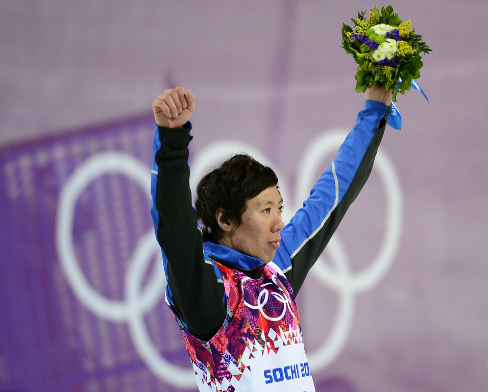 . Bronze Medallist, China\'s Jia Zongyang celebrates at the Men\'s Freestyle Skiing Aerials Flower Ceremony at the Rosa Khutor Extreme Park during the Sochi Winter Olympics on February 17, 2014.  JAVIER SORIANO/AFP/Getty Images