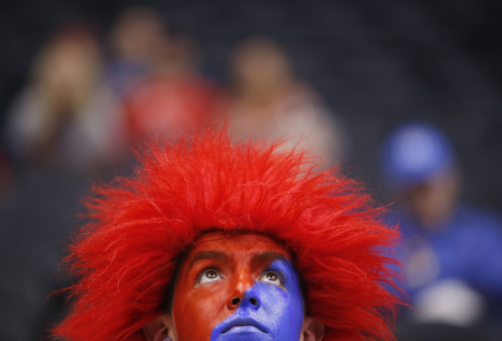 . Arizona band member Thomas Gonzalez shows off his colors before Arizona\'s West Regional semifinal against Ohio State in the NCAA men\'s college basketball tournament, Thursday, March 28, 2013, in Los Angeles. (AP Photo/Jae C. Hong)