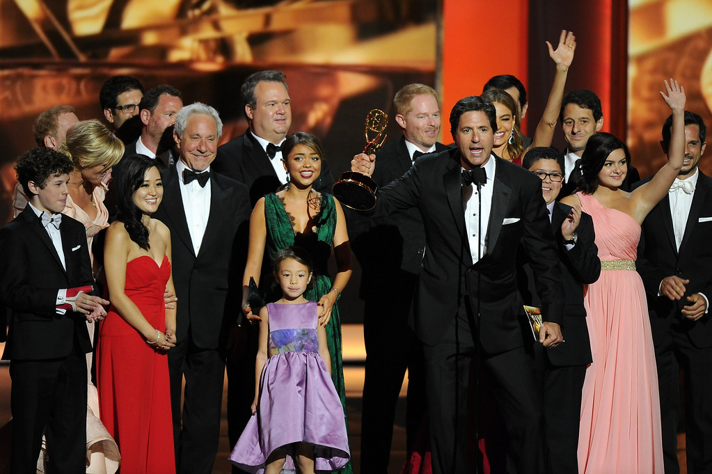 . Steven Levitan, foreground right, and the cast and crew of ìModern Familyî accept the award for outstanding comedy series at the 65th Primetime Emmy Awards at Nokia Theatre on Sunday Sept. 22, 2013, in Los Angeles.  (Photo by Chris Pizzello/Invision/AP)