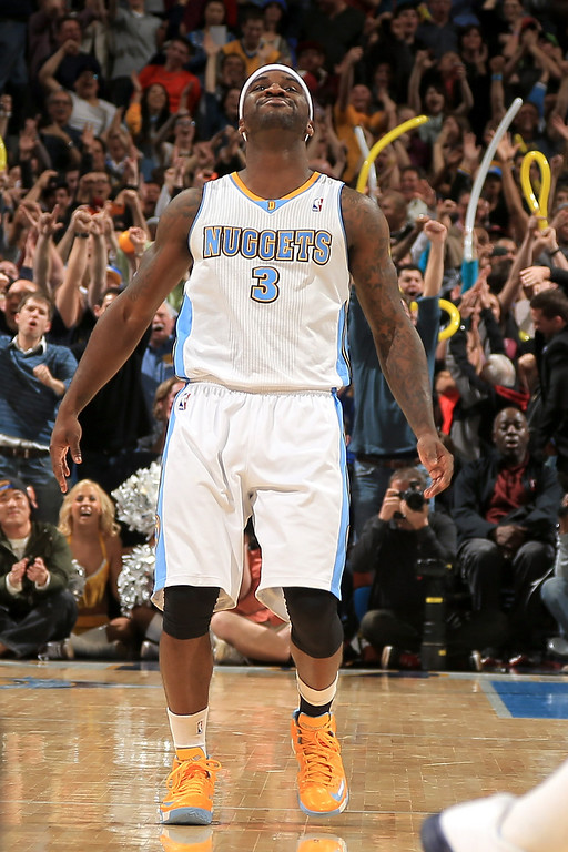 . DENVER, CO - MARCH 01:  Ty Lawson #3 of the Denver Nuggets celebrates after hitting the game winning shot against the Oklahoma City Thunder in the finals seconds at the Pepsi Center on March 1, 2013 in Denver, Colorado. The Nuggets defeated the Thunder 105-103. (Photo by Doug Pensinger/Getty Images)