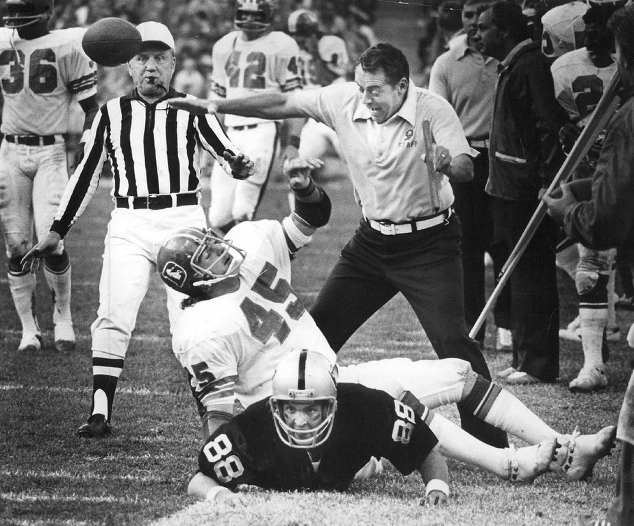 . Linebacker Bill Laskey had just intercepted pass that stopped Oakland\'s last minute drive, ensuring a Bronco win. Bronco coach Ralston jumps into the middle of play on the side lines, as Laskey tosses ball into the air No. 88 is Bob Moore,  Oakland tight end.  (Photo by Barry Staver/Denver Post)