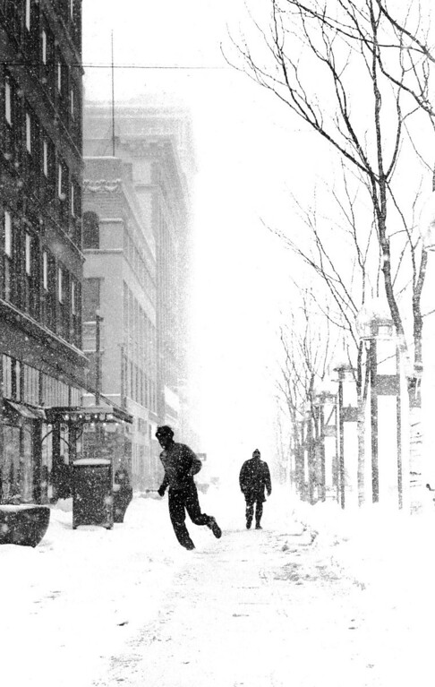 . People hustle through the snow during the Blizzard Of \'82. Denver Post Library Archive