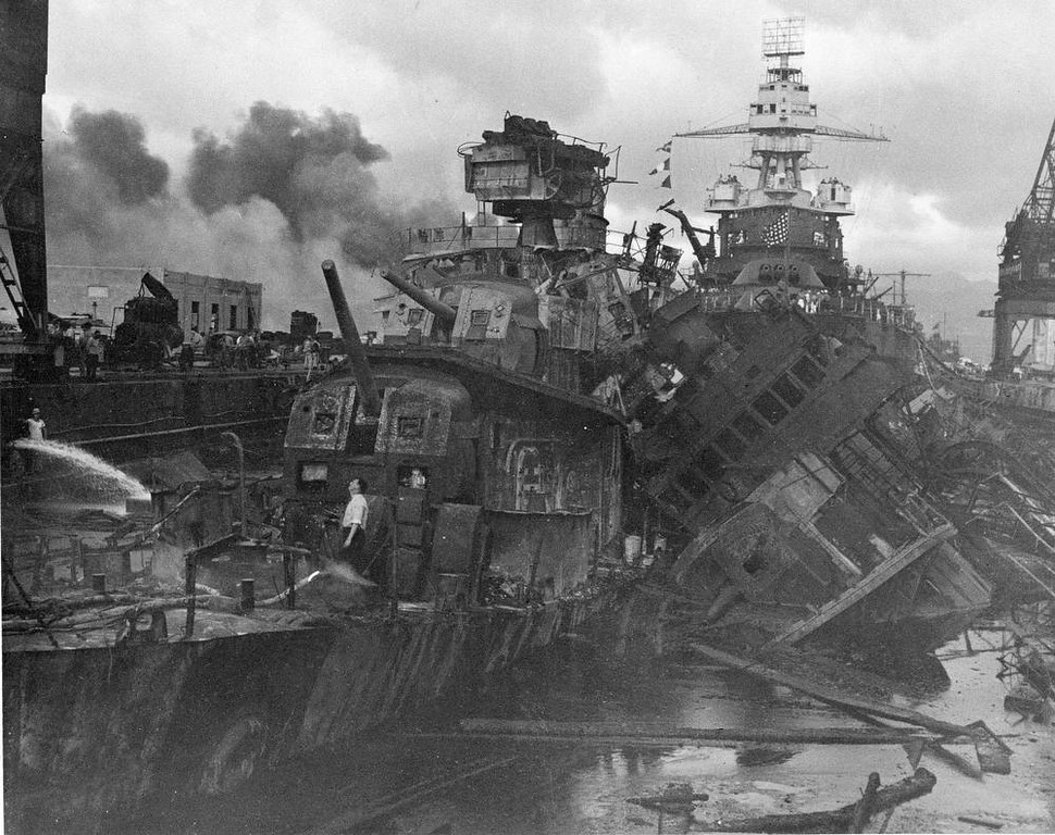 . This Dec. 1941 file photo shows heavy damage to ships stationed at Pearl Harbor after the Japanese attack on the Hawaiian island on Dec. 7, 1941. The most comparable attack against the United States was the surprise Japanese bombing of Pearl Harbor on Dec. 7, 1941, that plunged the U.S. into war. The nation marked the 10-year anniversary of Pearl Harbor much differently than now. Just like the 10-year anniversary of Sept. 11, how the nation experienced the anniversary of Pearl Harbor was shaped by what was happening in the world in 1951. (AP Photo/U.S. Navy)