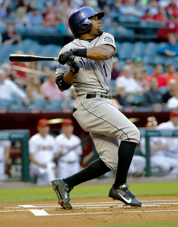 . Colorado Rockies\' Eric Young Jr. follows through on a base hit against the Arizona Diamondbacks during the first inning of a baseball game, Thursday, April 25, 2013, in Phoenix. (AP Photo/Matt York)