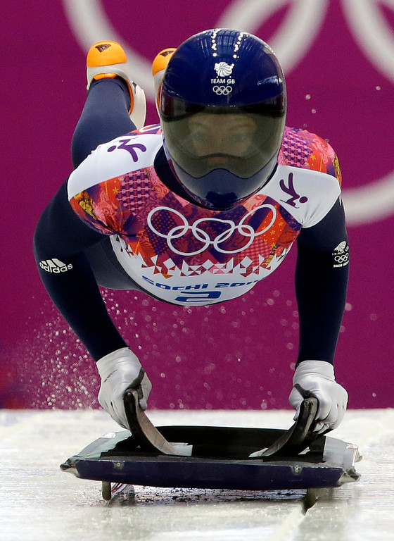 . Elizabeth Yarnold of Great Britain starts her first run during the women\'s skeleton competition at the 2014 Winter Olympics, Thursday, Feb. 13, 2014, in Krasnaya Polyana, Russia. (AP Photo/Dita Alangkara)