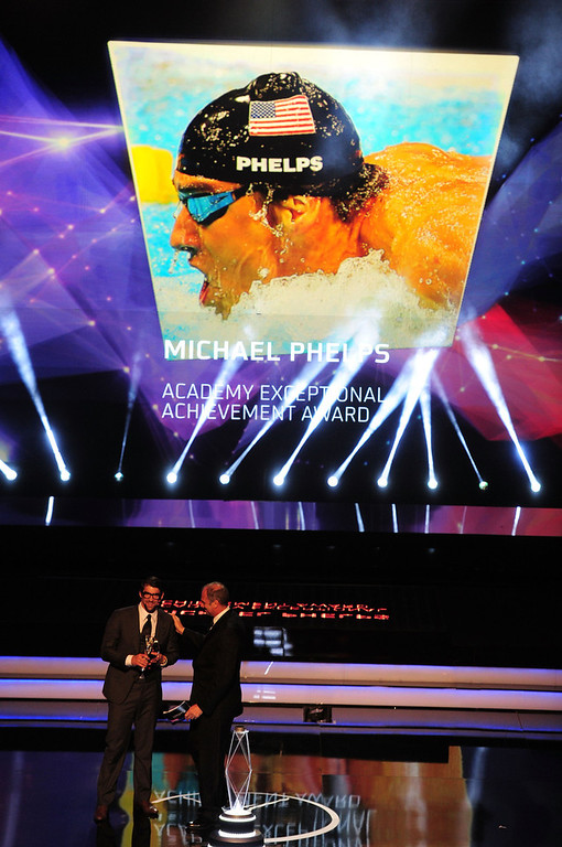 . Michael Phelps receives his  Laureus Academy Exceptional Acheivement Award from Laureus Academy Member Sir Steve Redgrave during the awards show for the 2013 Laureus World Sports Awards at the Theatro Municipal Do Rio de Janeiro on March 11, 2013 in Rio de Janeiro, Brazil.  (Photo by Jamie McDonald/Getty Images For Laureus)
