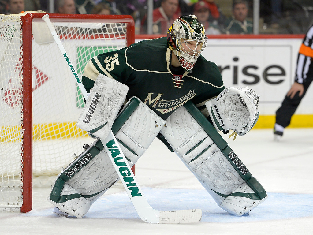 . Minnesota Wild goalie Darcy Kuemper (35) looks for the puck during the second period agains the Colorado Avalanche April 24, 2014 in Game 4 of the Stanley Cup Playoffs at Xcel Energy Center. (Photo by John Leyba/The Denver Post)