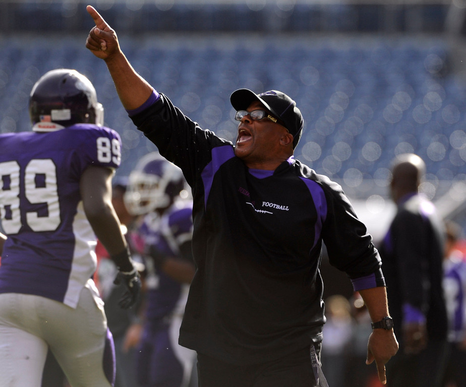 . Pointing to an instant replay on the large screen, Rebel\'s head coach Tom Lindsay Sr. protests a call near the end of the 3rd quarter saying that Denver South did not get in the end zone. Denver South High School takes on Monarch High School in the second half in the 4A Colorado State Football Championships at Sports Authority Field at MIle High in Denver on Saturday, Dec. 1, 2012. Kathryn Scott Osler, The Denver Post