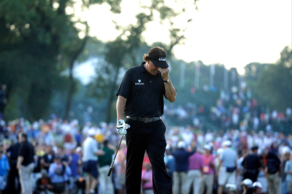 . Phil Mickelson reacts after missing a shot on the 18th hole during the fourth round of the U.S. Open golf tournament at Merion Golf Club, Sunday, June 16, 2013, in Ardmore, Pa. (AP Photo/Morry Gash)