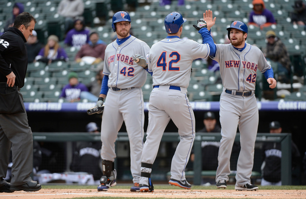 . David Wright (M) of the New York Mets high fives Daniel Murphy after hitting a home run in the first inning April 16, 2013 at Coors Field. Both teams wore the number 42 on their jersey in honor of Jackie Robinson. (Photo By John Leyba/The Denver Post)