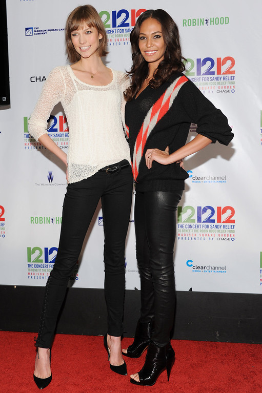 ". From left, models Karlie Kloss and Chanel Iman appear backstage at ""12-12-12\"" The Concert for Sandy Relief, on Wednesday, Dec. 12, 2012 in New York. (Photo by Evan Agostini/Invision/AP Images)"