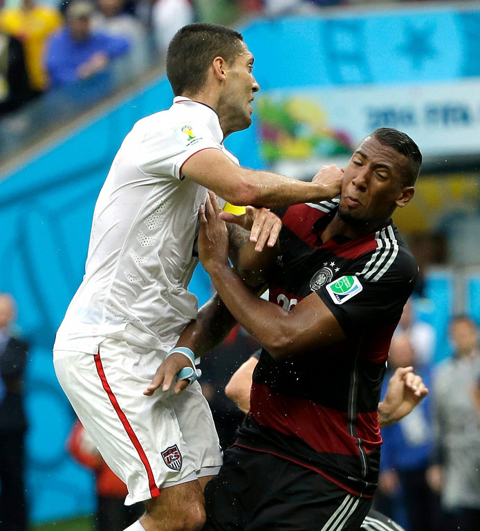 . United States\' Clint Dempsey runs into Germany\'s Jerome Boateng during the group G World Cup soccer match between the USA and Germany at the Arena Pernambuco in Recife, Brazil, Thursday, June 26, 2014. (AP Photo/Ricardo Mazalan)