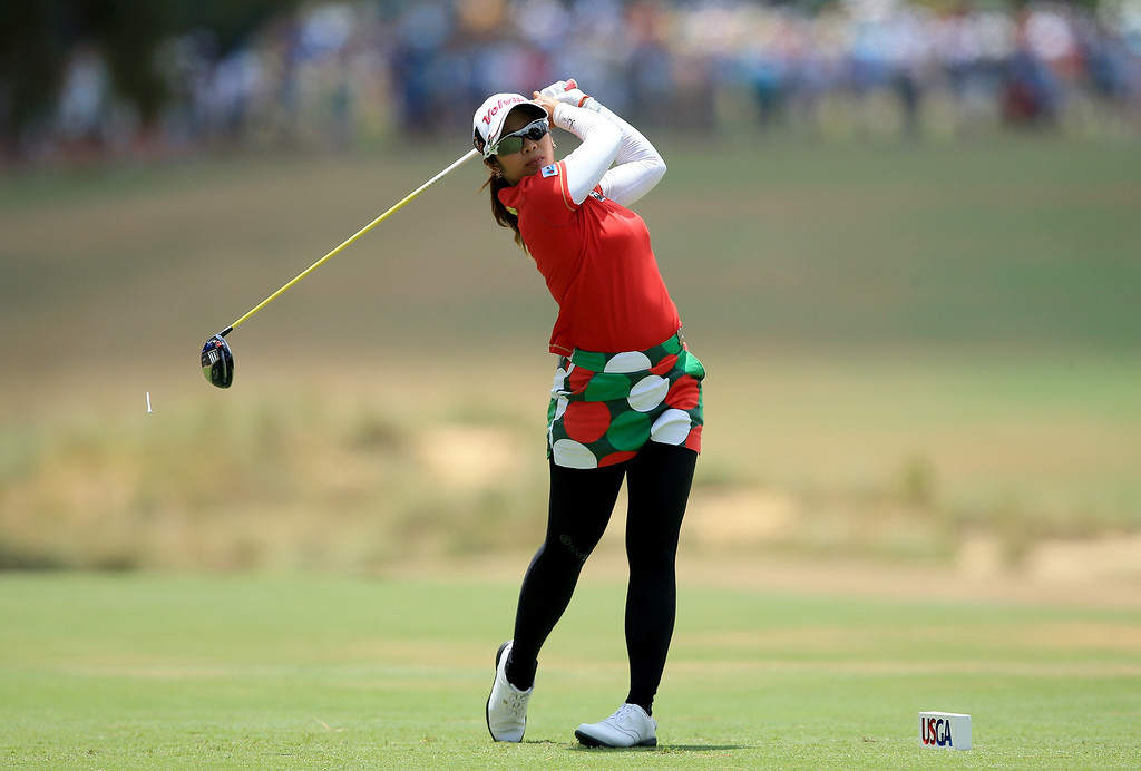 . Pornanong Phatlum of Thailand plays her tee shot at the par 4, second hole during the final round of the 69th U.S. Women\'s Open at Pinehurst Resort & Country Club, Course No. 2, on June 22, 2014 in Pinehurst, North Carolina.  (Photo by David Cannon/Getty Images)