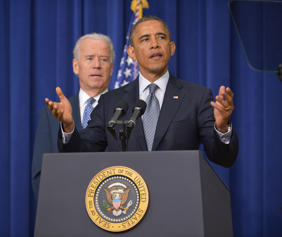 . US President Barack Obama speaks on proposals to reduce gun violence as Vice President Joe Biden watches on January 16, 2013 in the South Court Auditorium of the Eisenhower Executive Office Building, next to the White House in Washington, DC. Obama is expected to sign 23 executive actions to curb gun violence.  AFP PHOTO/Mandel  NGAN/AFP/Getty Images