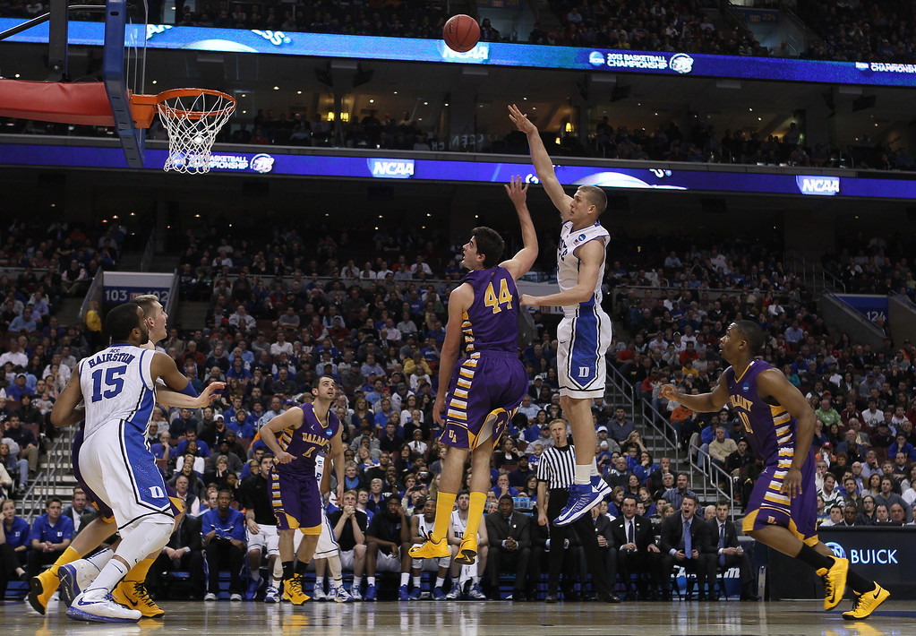 . Mason Plumlee #5 of the Duke Blue Devils shoots over John Puk #44 of the Albany Great Danes in the second half during the second round of the 2013 NCAA Men\'s Basketball Tournament on March 22, 2013 at Wells Fargo Center in Philadelphia, Pennsylvania.  (Photo by Elsa/Getty Images)