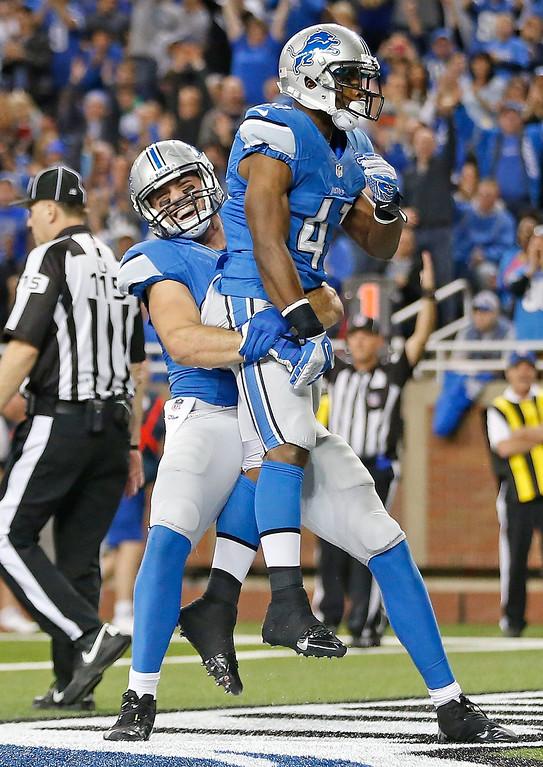 . Theo Riddick #41 of the Detroit Lions celebrates after scoring on a short run with teammate Joseph Fauria #80 during the fourth quarter of the game againsts the New York Giants at Ford Field on December 22, 2013 in Detroit, Michigan.  (Photo by Leon Halip/Getty Images)