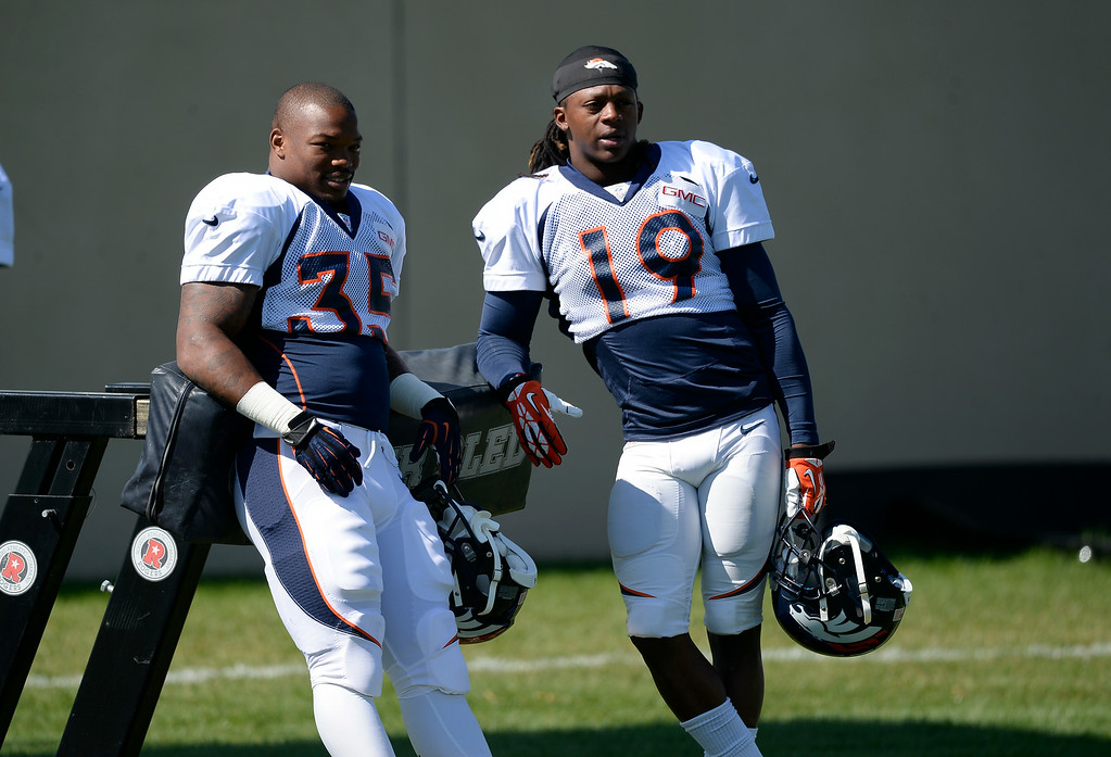 . Denver Broncos running back Kapri Bibbs (35) and Denver Broncos wide receiver Isaiah Burse (19) hangout as they wait for practice to begin at the Denver Broncos 2014 training camp August 11, 2014 at Dove Valley. (Photo by John Leyba/The Denver Post)