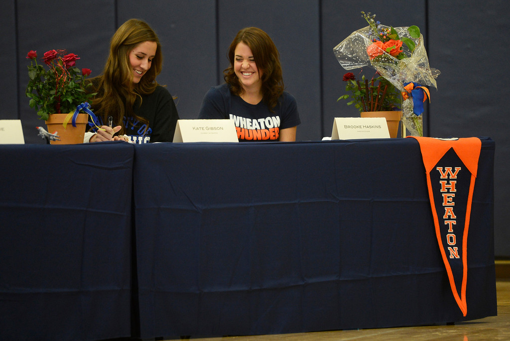 . HIGHLANDS RANCH, CO. - FEBRUARY 05: Valor Christian High School volleyball teammates, Kate Gibson, left, and Brooke Haskins, have a laugh together during a National Letter of Intent Day assembly at Valor Christian  Wednesday morning, February 05, 2014. Gibson signed with the University of Memphis, and Haskins signed with Wheaton College.  (Photo By Andy Cross / The Denver Post)