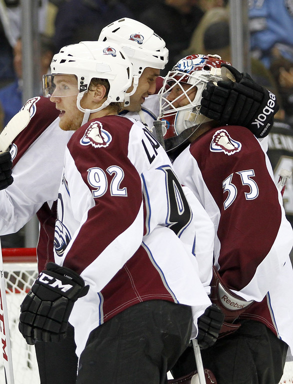 . Patrick Bordeleau #58 of the Colorado Avalanche celebrates with Jean-Sebastien Giguere #35 after shutting out the Pittsburgh Penguins 1-0 at Consol Energy Center on October 21, 2013 in Pittsburgh, Pennsylvania.  (Photo by Justin K. Aller/Getty Images)