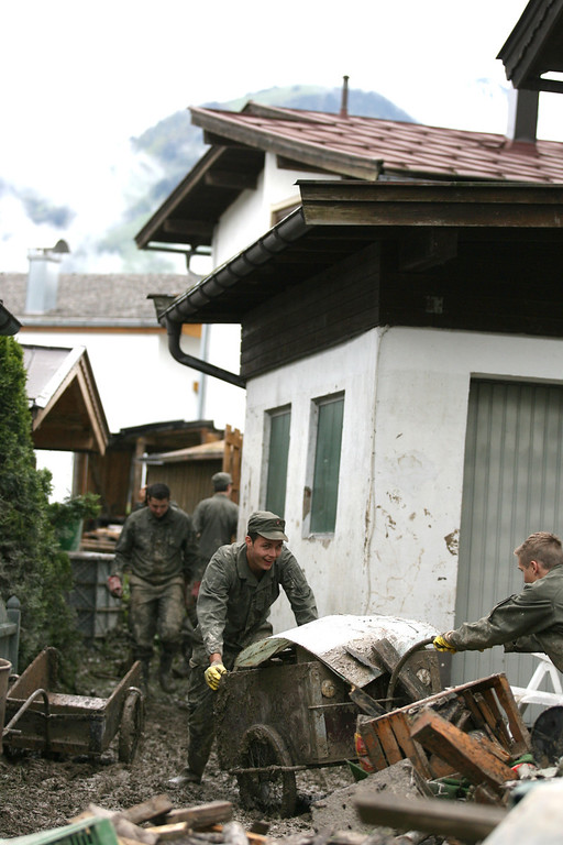 . This picture taken on June 4, 2013 shows army helping to put damaged furniture outside the houses following flooding in Kossen. All long-distance rail services west of Vienna -- including to Germany and Switzerland -- were suspended late Sunday due to flooding along the line, as hundreds around the country were evacuated from their homes and the search for two missing people continued.  PIERRE TEYSSOT/AFP/Getty Images