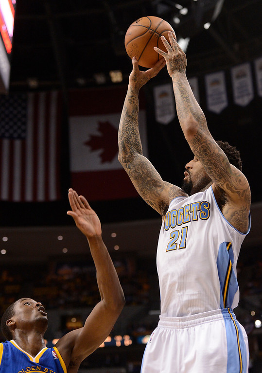 . Denver Nuggets shooting guard Wilson Chandler (21) puts up a shot in the second quarter. The Denver Nuggets took on the Golden State Warriors in Game 5 of the Western Conference First Round Series at the Pepsi Center in Denver, Colo. on April 30, 2013. (Photo by John Leyba/The Denver Post)