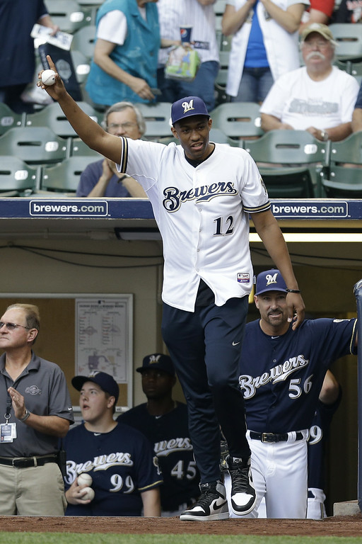 . MILWAUKEE, WI - JUNE 28: Milwaukee Bucks 2014 Draft Pick Jabari Parker throws out the first pitch before the game between the Colorado Rockies and the Milwaukee Brewers at Miller Park on June 28, 2014 in Milwaukee, Wisconsin. (Photo by Mike McGinnis/Getty Images)