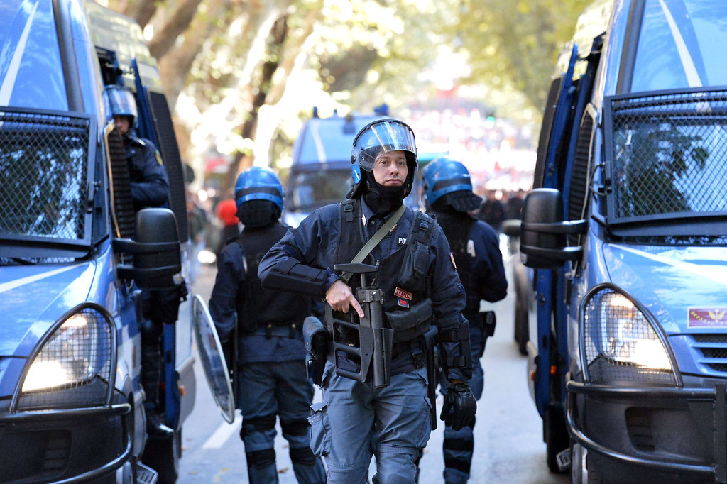 . Anti-riot policemen patrol during an anti-austerity protest on October 19, 2013 in Rome. Between 3,000 and 4,000 police officers have been deployed, Italian media reports said, and protest organizers say they expect more than 20,000 to join.  ALBERTO PIZZOLI/AFP/Getty Images