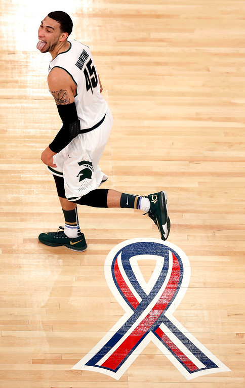 . Michigan State guard Denzel Valentine reacts after scoring against Connecticut during the first half in a regional semifinal at the NCAA college basketball tournament on Sunday, March 30, 2014, in New York. (AP Photo/Julio Cortez)