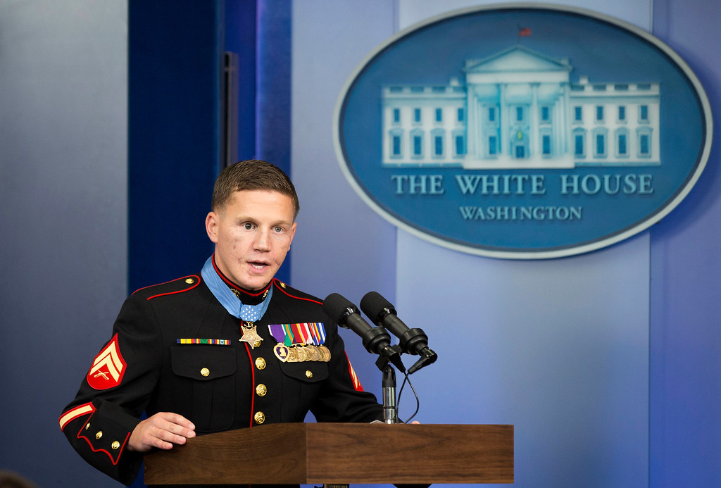 """. Retired Marine Cpl. William \""""Kyle\"""" Carpenter, 24, currently a student at the University of South Carolina, speaks in the Brady Press Briefing Room of the White House in Washington, Thursday, June 14, 2014, after being awarded the Medal of Honor by President Barack Obama.  (AP Photo/Jacquelyn Martin)"""
