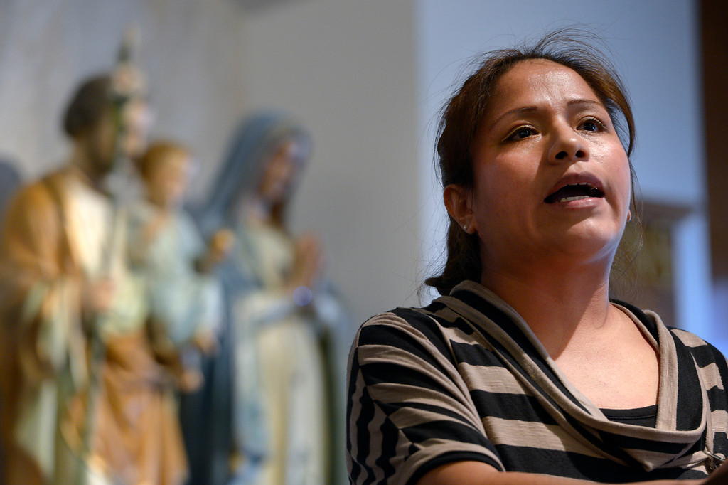 . AURORA, CO- FEBRUARY 9: Illegal immigrant Kelly Castaneda speaks to the audience of her fears about being deported while he daughter will be left in the United States.  TOGETHER COLORADO held a public meeting  to talk about the United States immigration policies at St. Therese Catholic Church, 1243 Kingston Street in Aurora, Co  on February 9th, 2013.   Colorado State Senator Michael Bennet, and Colorado Representatives Mike Coffman and Jared Polis attended and spoke at the meeting.  The organization wanted to tell the state\'s representatives why they want a road map to citizenship for 11 million aspiring Americans.  More than 800 faith and community leaders packed the small church in Aurora. (Photo By Helen H. Richardson/ The Denver Post)