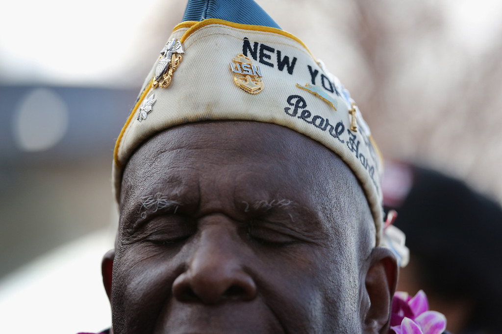 . Pearl Harbor survivor Clark Simmons, 92, takes part in a ceremony marking the 72nd anniversary of the attack on Pearl Harbor, Hawaii on December 7, 2013 in New York City.  (Photo by John Moore/Getty Images)