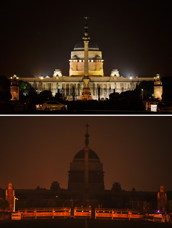 . In this two photo combination picture, the Indian Presidential Palace is seen lit, top, and then the same location in darkness when the lights are turned out for one hour to mark Earth Hour, in New Delhi, India, Saturday, March 23, 2013. Earth Hour was marked worldwide at 8.30 p.m. local time and is a global call to turn off lights for 60 minutes in a bid to highlight the global climate change. (AP Photo/Altaf Qadri)