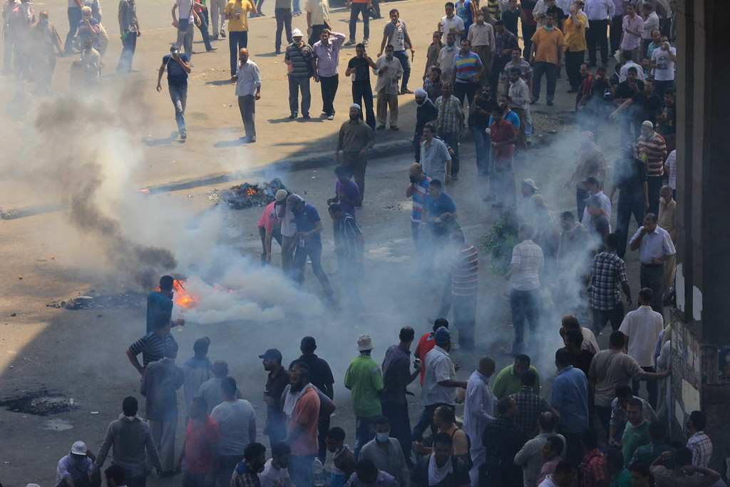 . Supporters of Egypt\'s ousted President Mohammed Morsi clash with security forces near the largest sit-in by supporters of Morsi in the eastern Nasr City district of Cairo, Egypt, Wednesday, Aug. 14, 2013.  (AP Photo/Mohammed Abu Zeid)