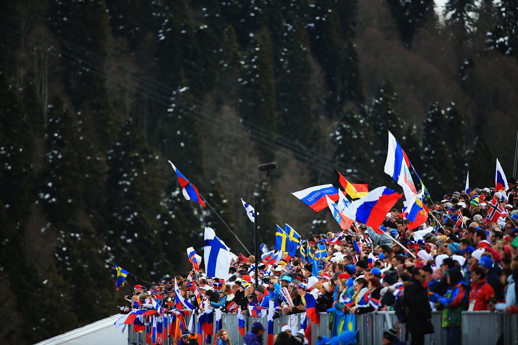 . SOCHI, RUSSIA - FEBRUARY 09:  Spectators wave flags during the Men\'s Skiathlon 15 km Classic + 15 km Free during day two of the Sochi 2014 Winter Olympics at Laura Cross-country Ski & Biathlon Center on February 9, 2014 in Sochi, Russia.  (Photo by Richard Heathcote/Getty Images)