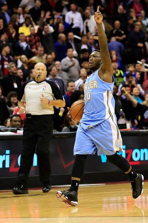 . Nate Robinson #10 of the Denver Nuggets celebrates after the Nuggets defeated the Washington Wizards 75-74 at Verizon Center on December 9, 2013 in Washington, DC.   (Photo by Rob Carr/Getty Images)