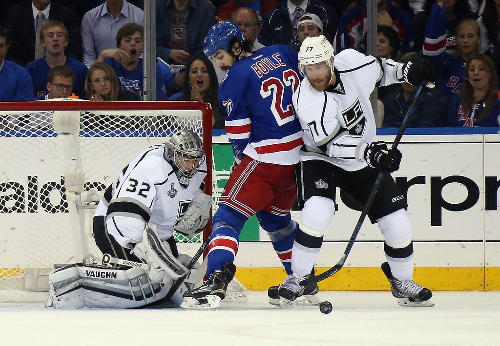 . Jeff Carter #77 and Jonathan Quick #32 of the Los Angeles Kings defend Brian Boyle #22 of the New York Rangers during the first period of Game Three of the 2014 NHL Stanley Cup Final at Madison Square Garden on June 9, 2014 in New York, New York.  (Photo by Bruce Bennett/Getty Images)