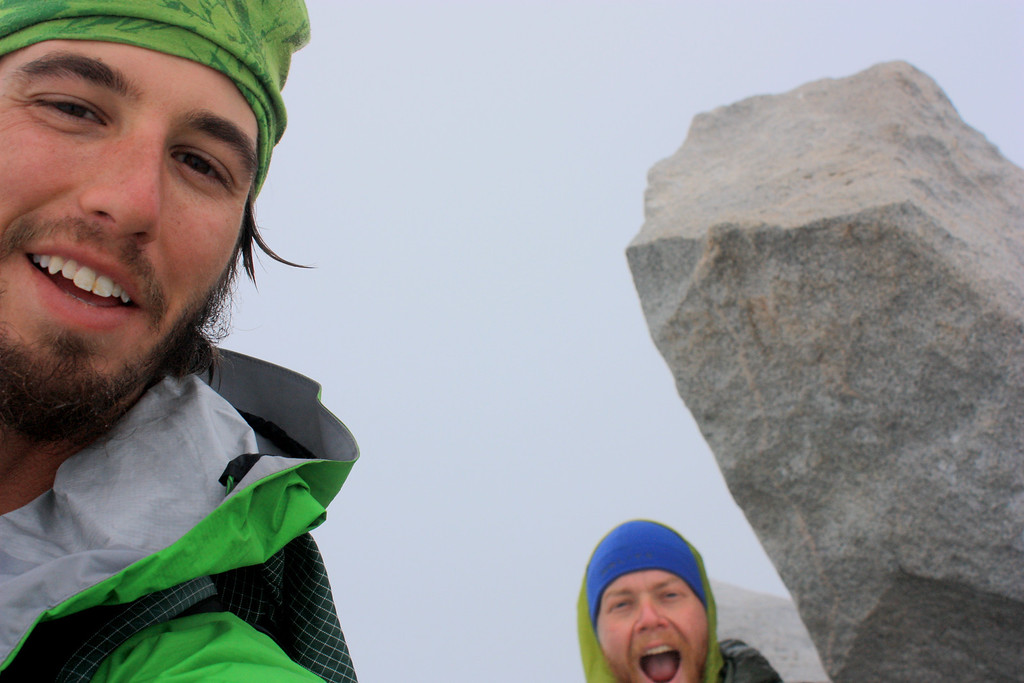 . Luke DeMuth, left, and Junaid Dawud celebrate on the summit of Snowmass Mountain in the Elk Mountain Range in August. The friends have hiked 1,300 miles and climbed 57 of the state\'s 58 14,000-foot peaks and plan to finish their 70-day mission Sunday on Longs Peak.