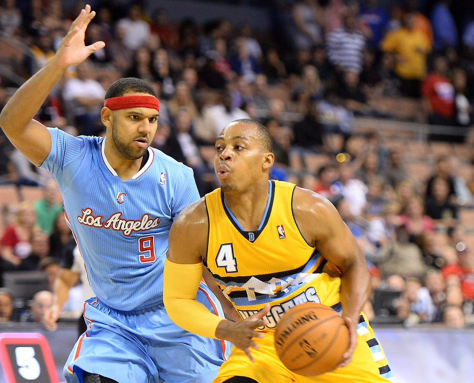 . Randy Foye #4 of the Denver Nuggets drives against Jared Dudley #9 of the Los Angeles Clippers during their preseason game at the Mandalay Bay Events Center on October 19, 2013 in Las Vegas, Nevada. Los Angeles won 118-111 in overtime.   (Photo by Ethan Miller/Getty Images)