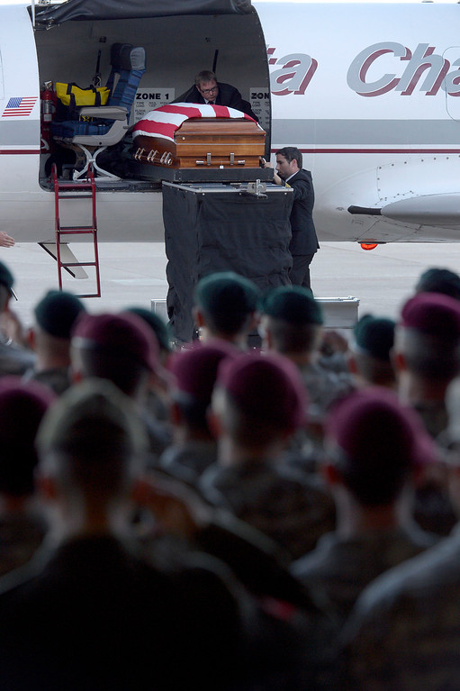 . Green Beret and Airborne salute one of their own as military officials brought the body of special forces staff sergeant Liam Nevins, 32, home from Dover AFB September 30, 2013 at Buckley AFB.  (Photo by John Leyba/The Denver Post)
